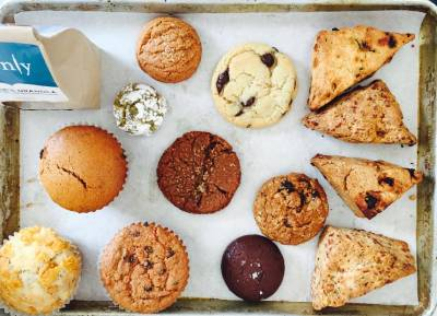 A tray of cookies, muffins, granola, and other baking treats