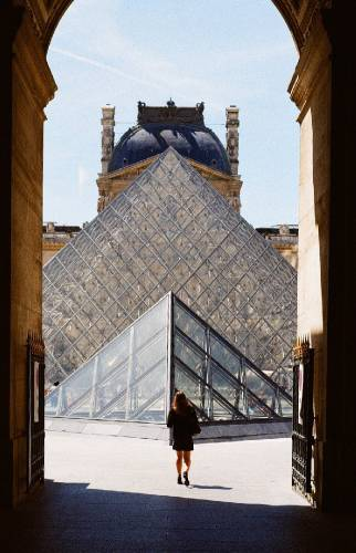 Louvre Pyramide in Paris on a sunny day