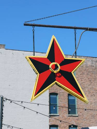 A hanging star sign outside the Big Star Bar in Chicago