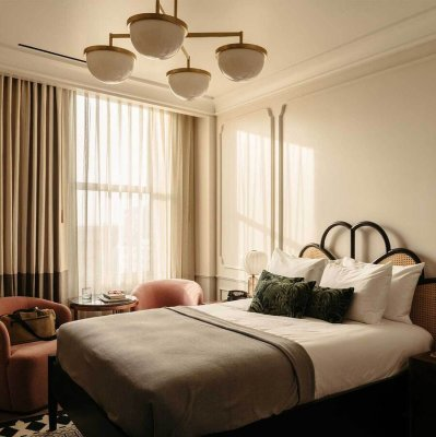 Bedroom at The Hoxton, DTLA with natural light streaming through the window
